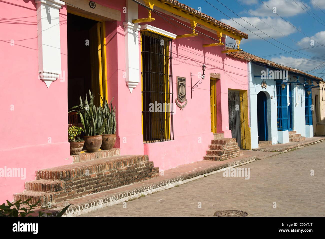 Colorful facade of colonial houses, Camaguey, Cuba Stock Photo ...