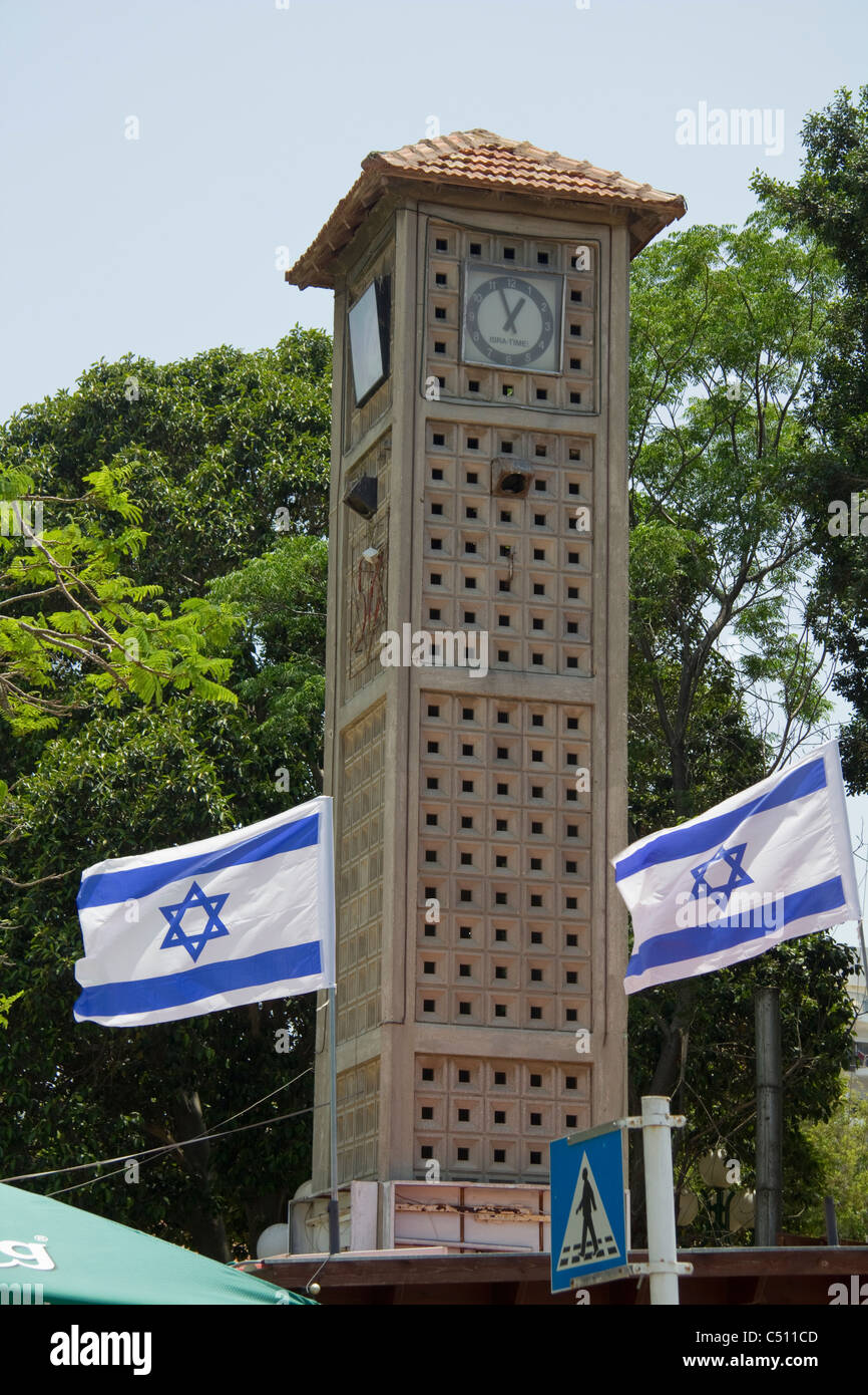 Ashkelon town centre, clock tower with Israeli flags, Israel - Stock Image