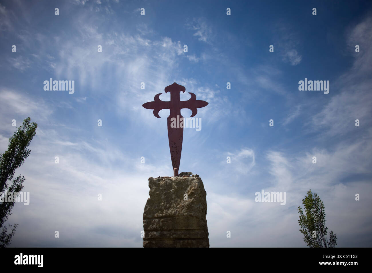 A Santiago Cross is displayed in the French Way of St. James Way, Galicia, Spain - Stock Image
