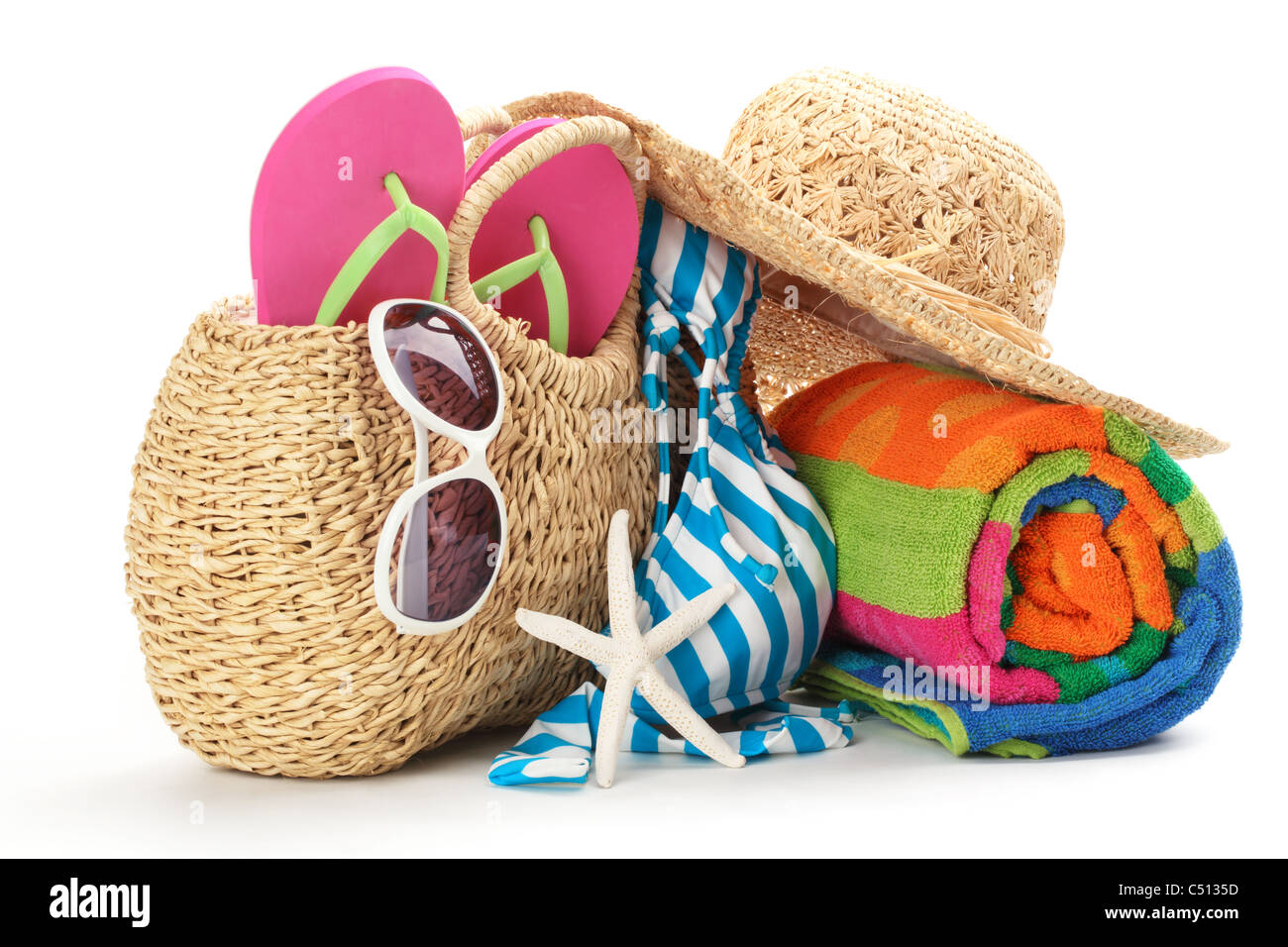 Beach items with swimming suit,towel,flip flops and sunglasses.Isolated on white background. - Stock Image