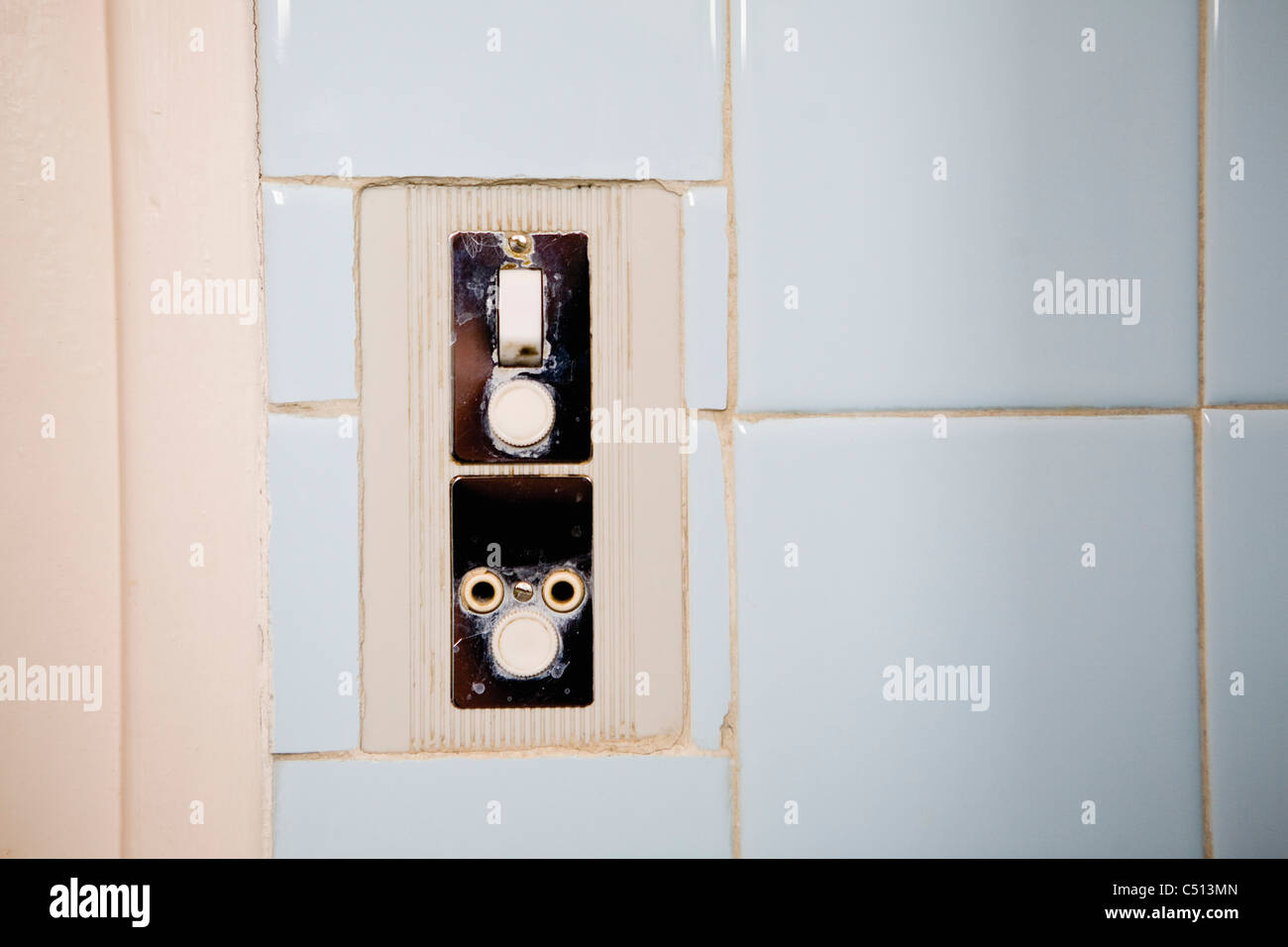 Light switch and electrical outlet - Stock Image