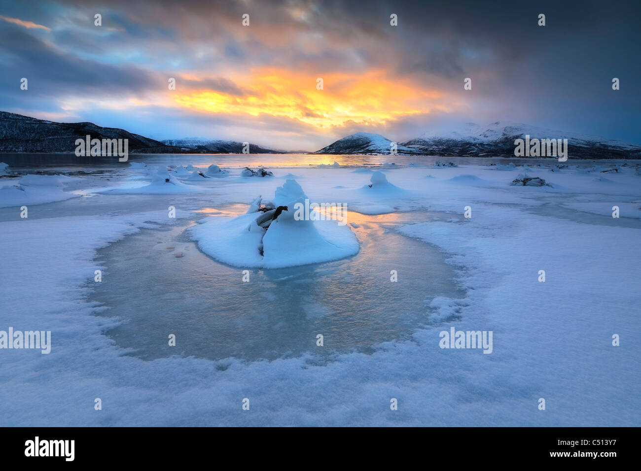 A frozen fjord that is part of Tjeldsundet strait in Troms County, Norway. Sætertinden mountain is in the background. - Stock Image