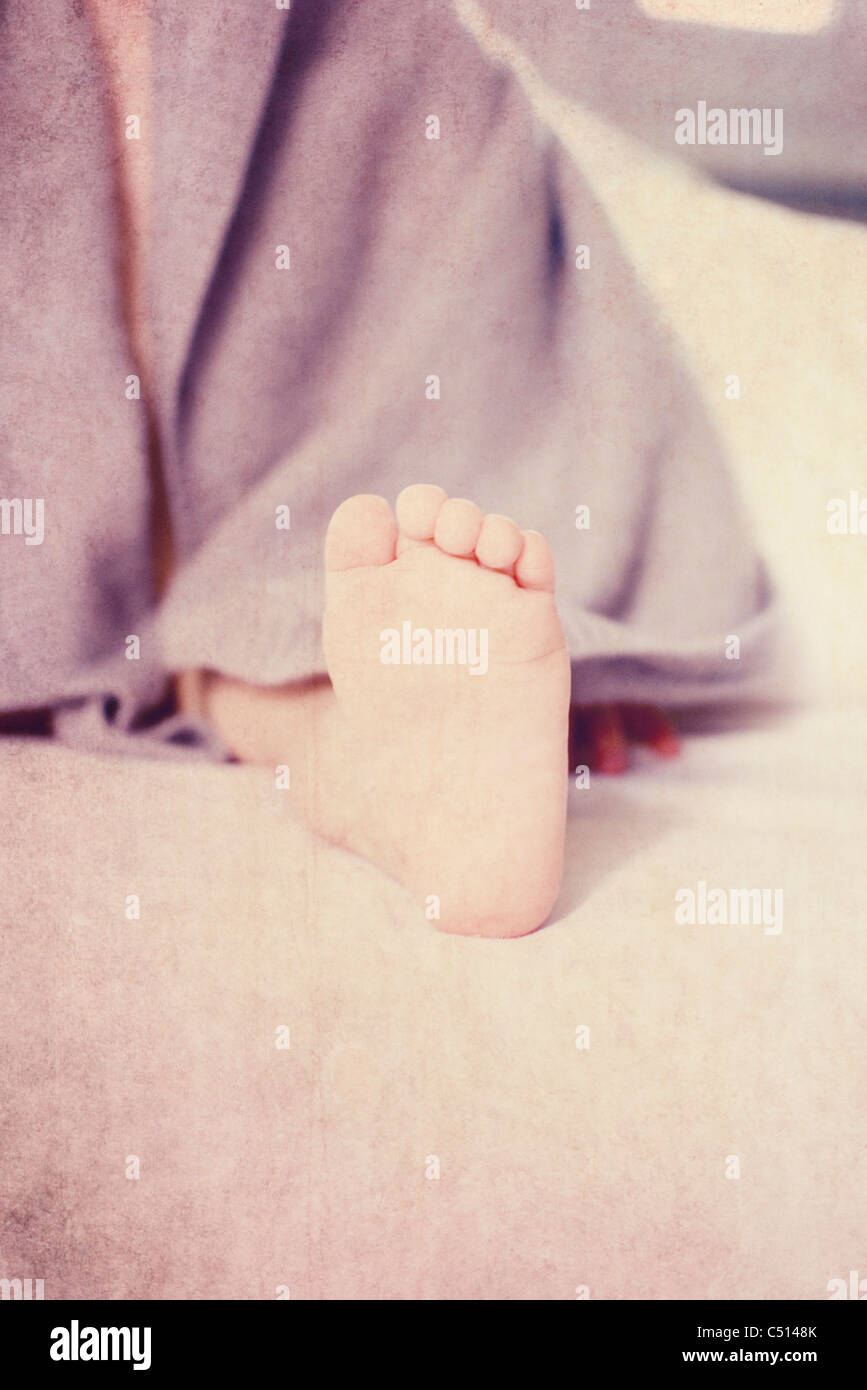 Baby's foot, cropped - Stock Image