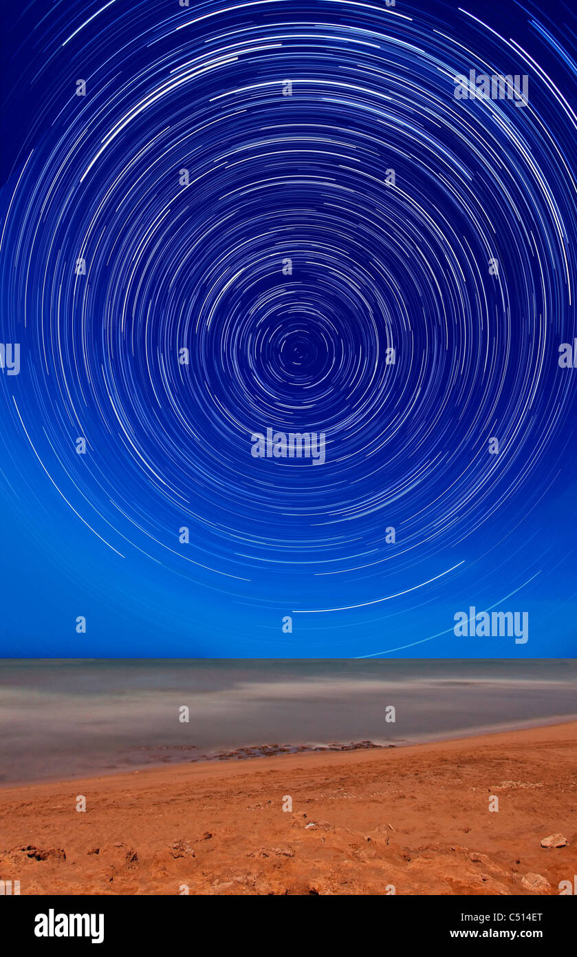 Star trails around the south celestial pole at the beach in Miramar, Argentina. - Stock Image