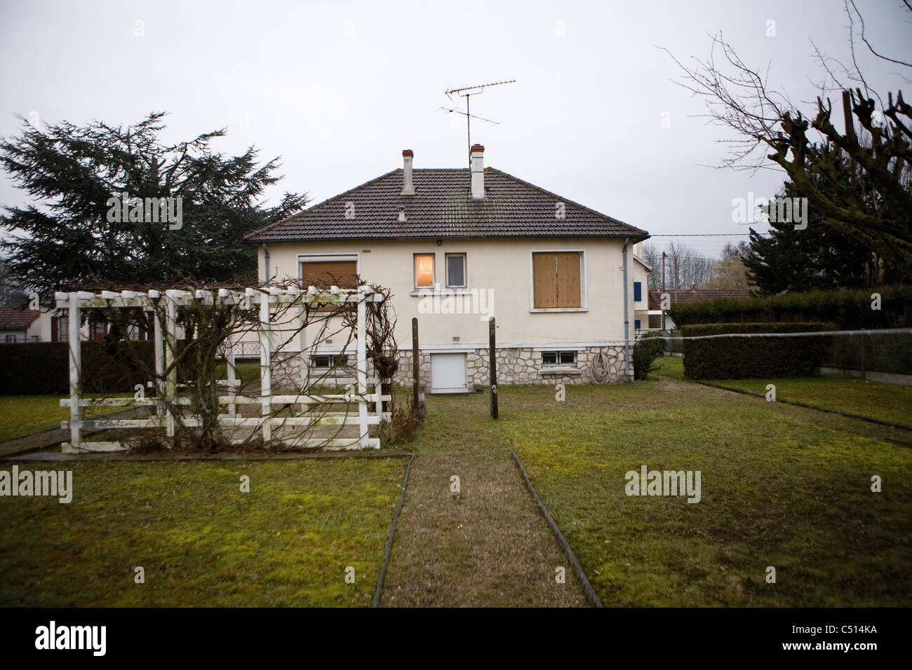 Rear of house and backyard - Stock Image