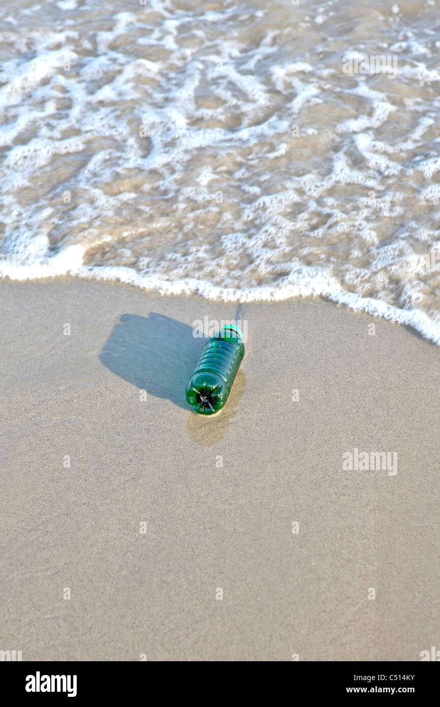 Plastic bottle washed up by the sea - Stock Image