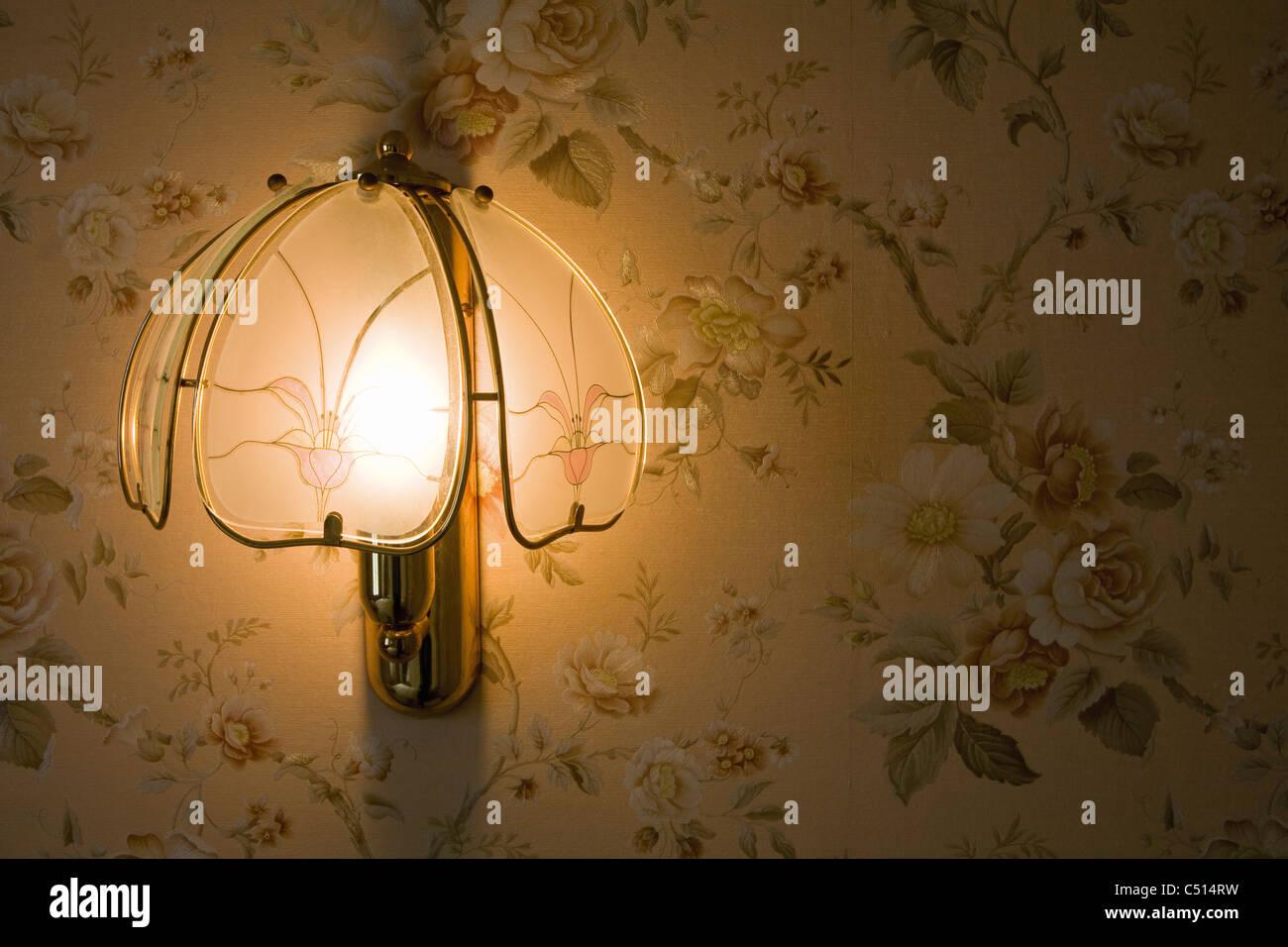 Decorative wall light illuminated at night Stock Photo