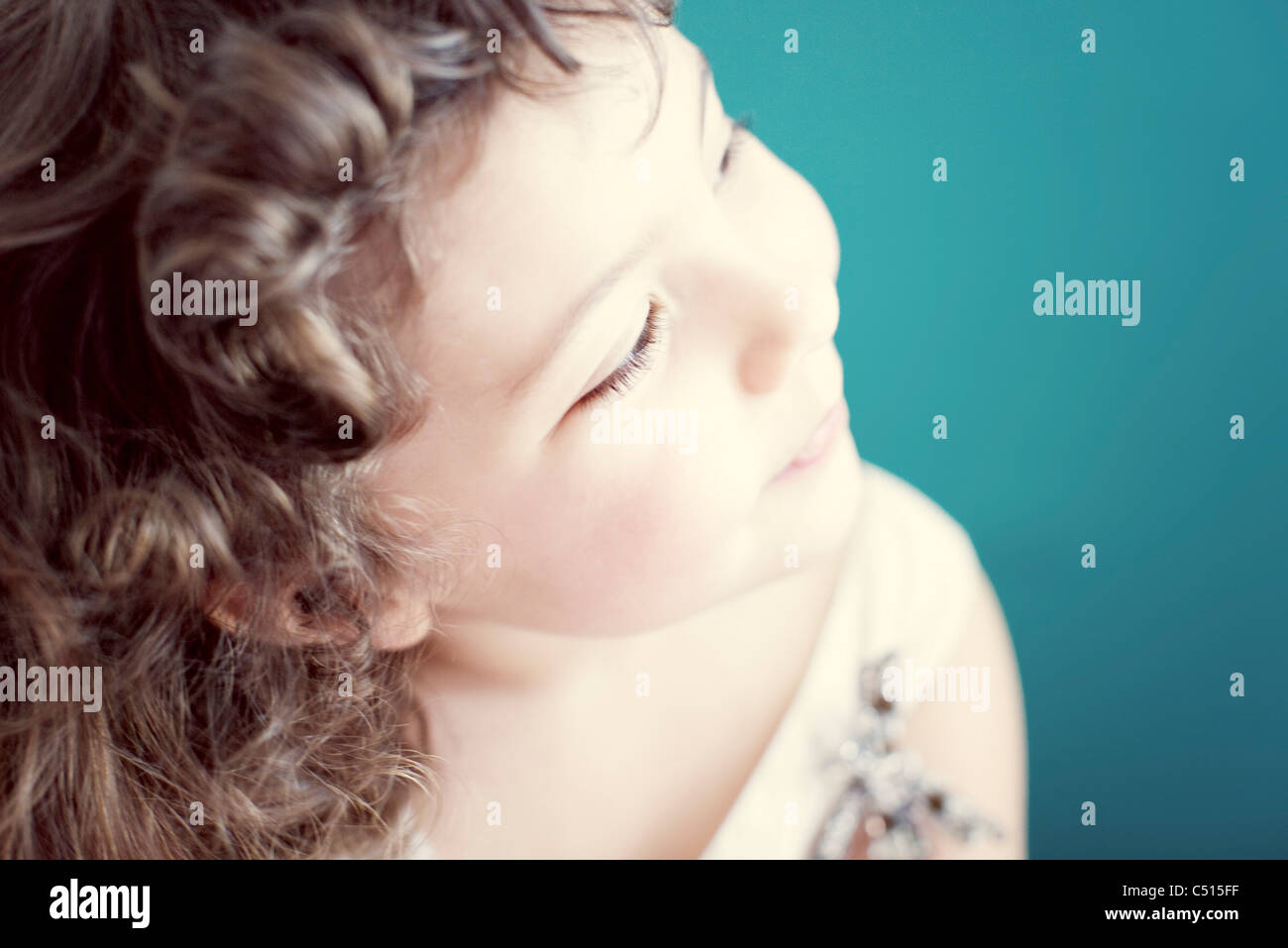 Little girl daydreaming - Stock Image