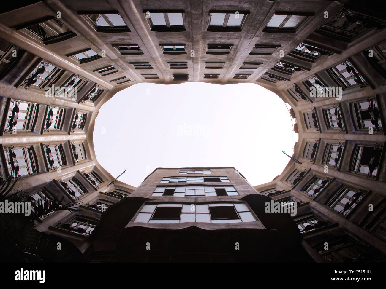 Spain, Barcelona, Casa Mila, atrium viewed from inner courtyard - Stock Image
