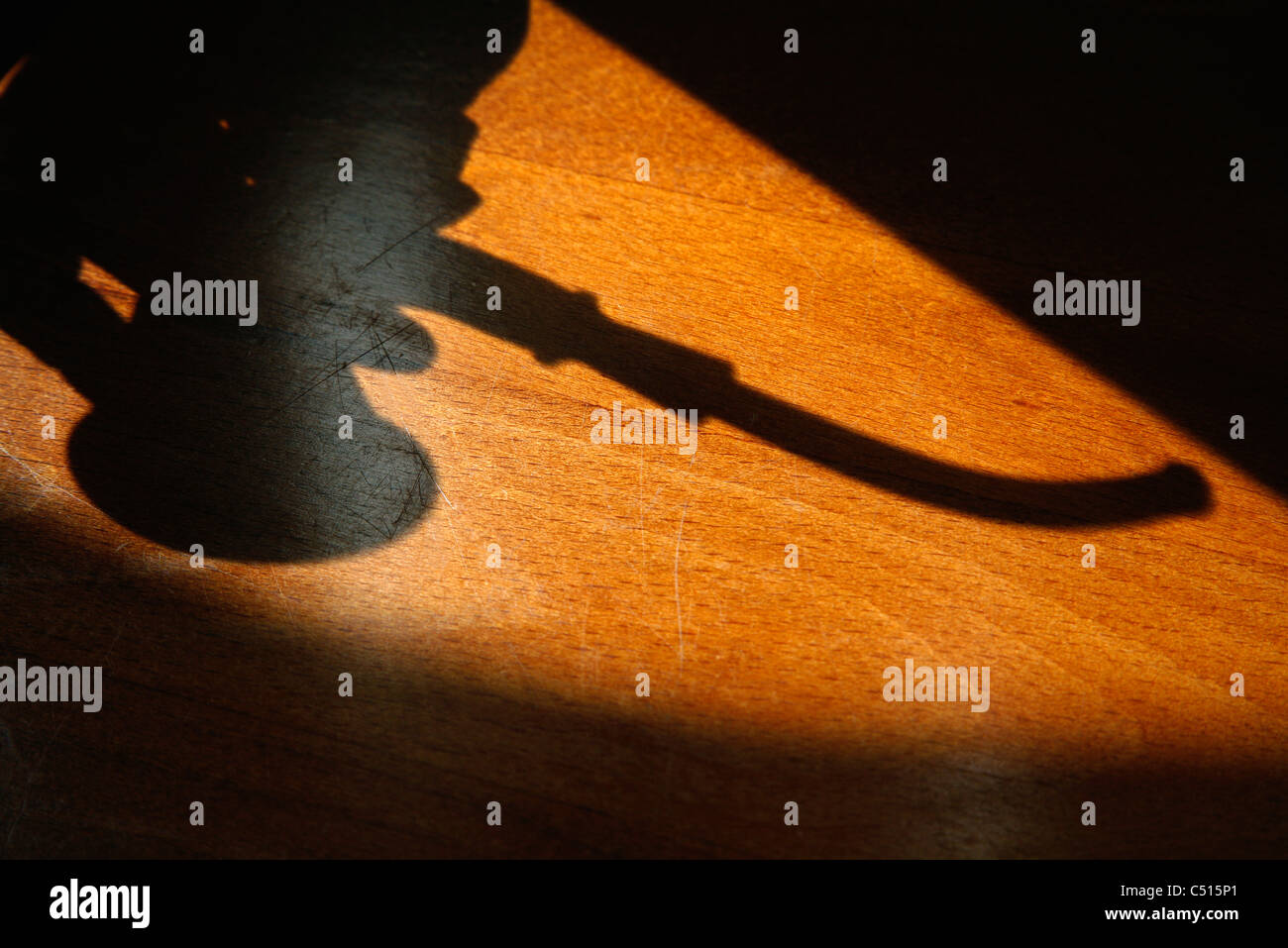 Shadow of smoking pipe - Stock Image