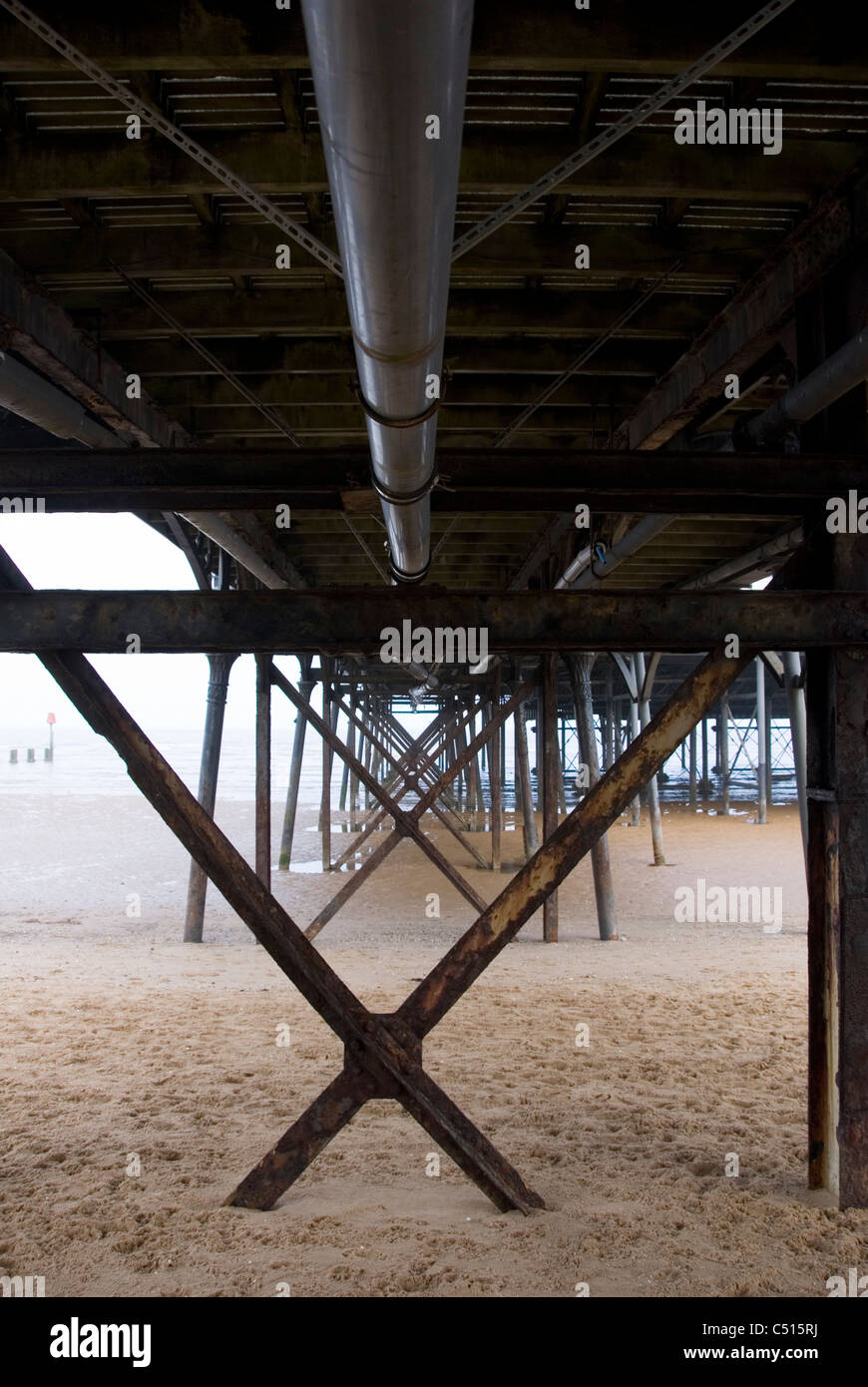 Steel Girders, Legs and Structural Supports Underneath The Pier, Cleethorpes, South Humberside UK - Stock Image