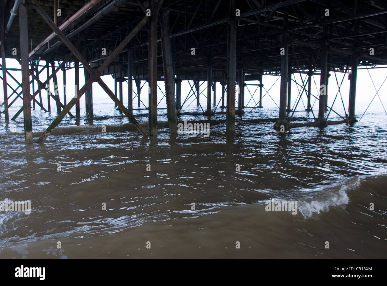 Steel Girders, Legs and Structural Supports Underneath The Pier, Cleethorpes, South Humberside, UK - Stock Image