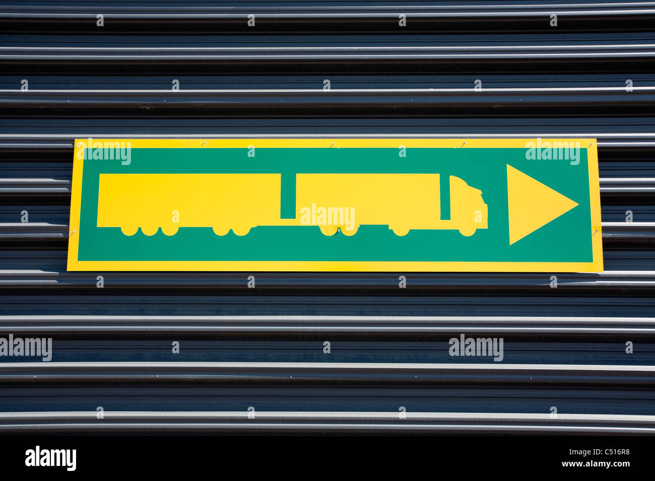 truck guidance sign on warehouse wall - Stock Image