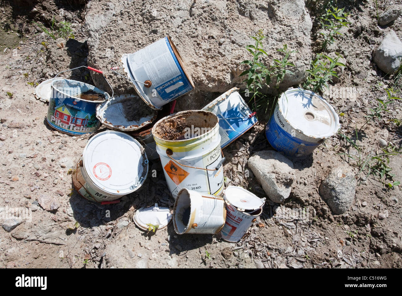 empty paint cans outdoors - Stock Image