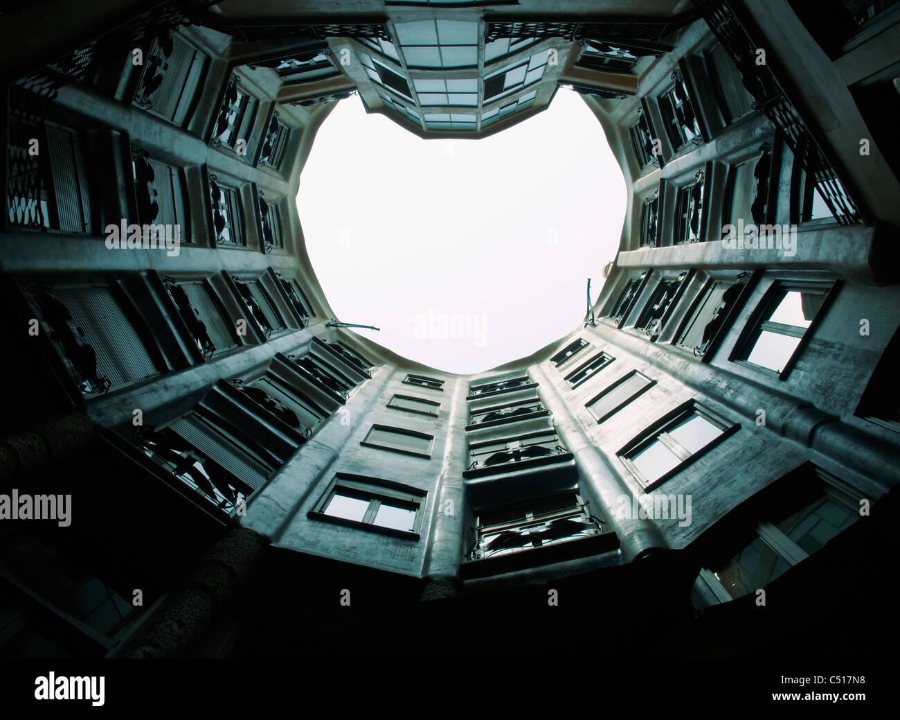 Spain, Barcelona, Casa Mila, atrium viewed from inner courtyard - Stock Image