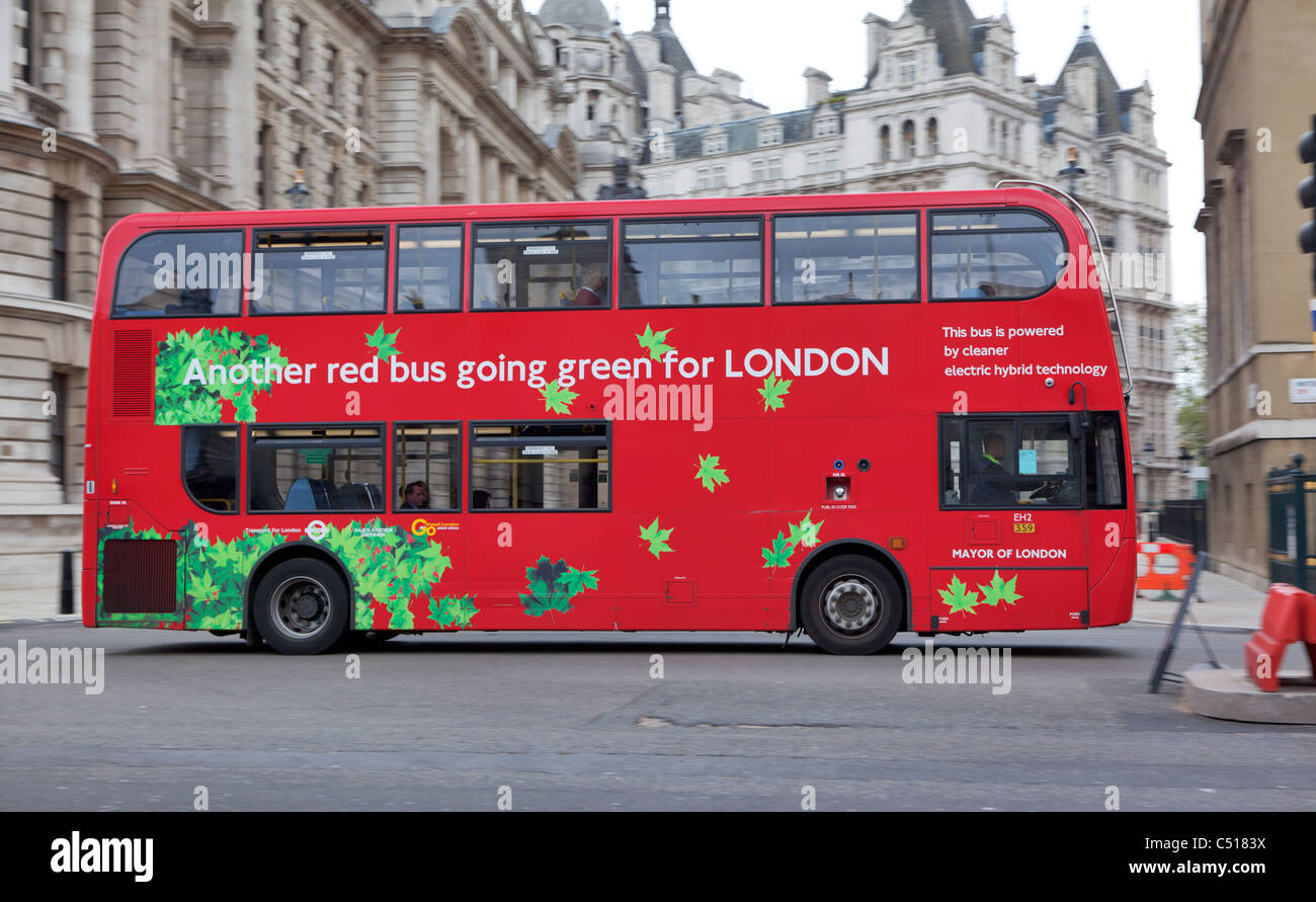 Another red bus going green for LONDON - Stock Image
