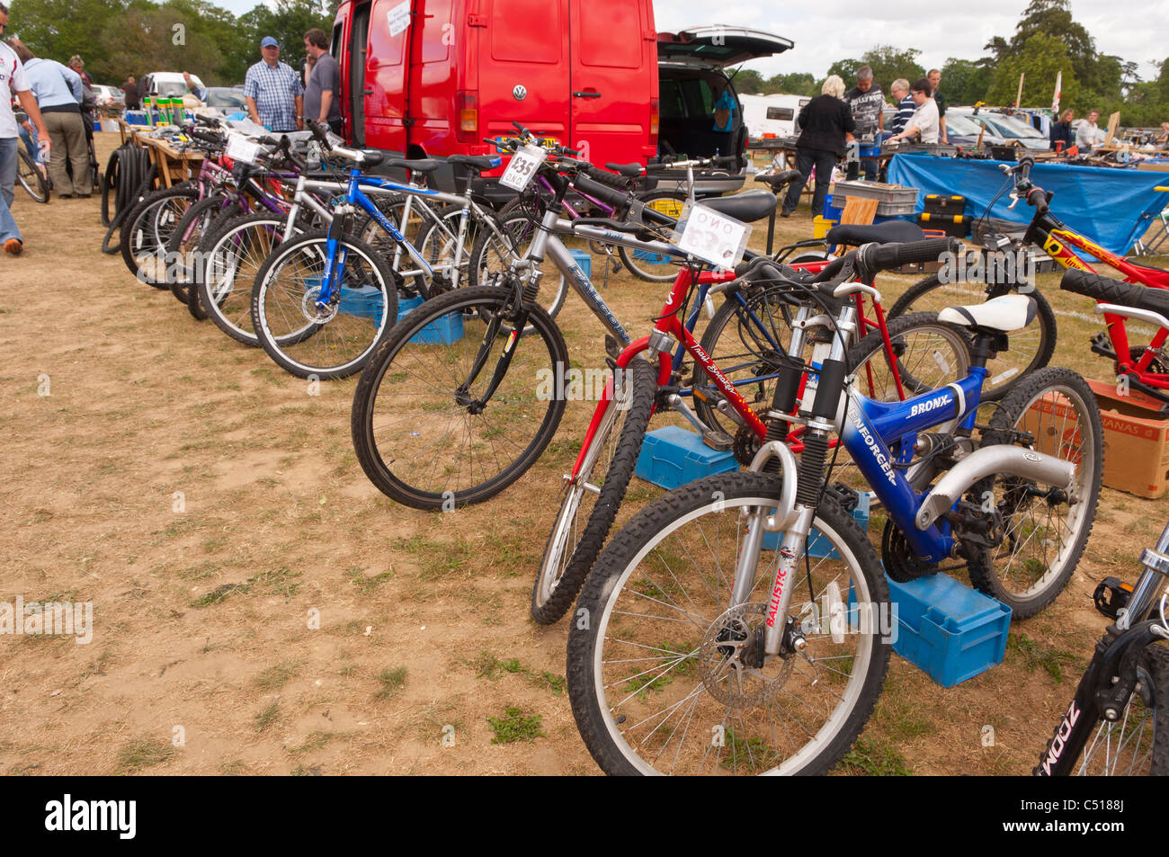 A used bikes stall selling bicycles on a car boot sale in Suffolk , England , Britain , Uk - Stock Image