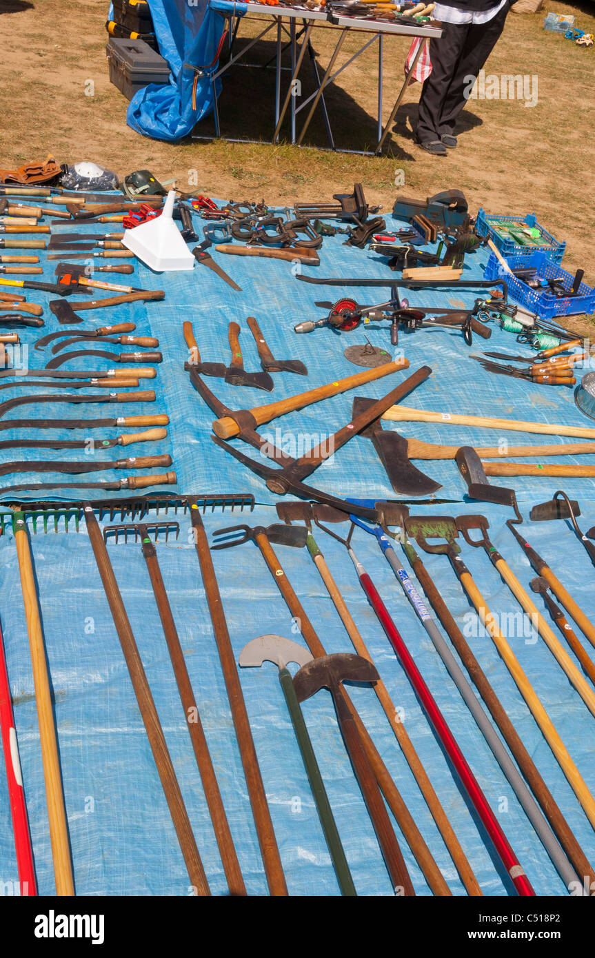 A used tools stall selling old tools on a car boot sale in Suffolk , England , Britain , Uk - Stock Image