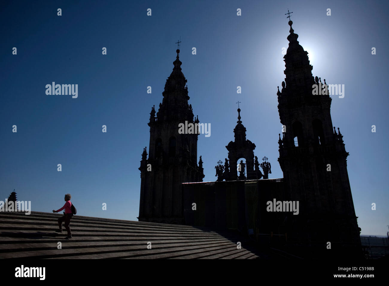 A tourist walks in the roof of the Cathedral of Santiago de Compostela, Spain. Stock Photo