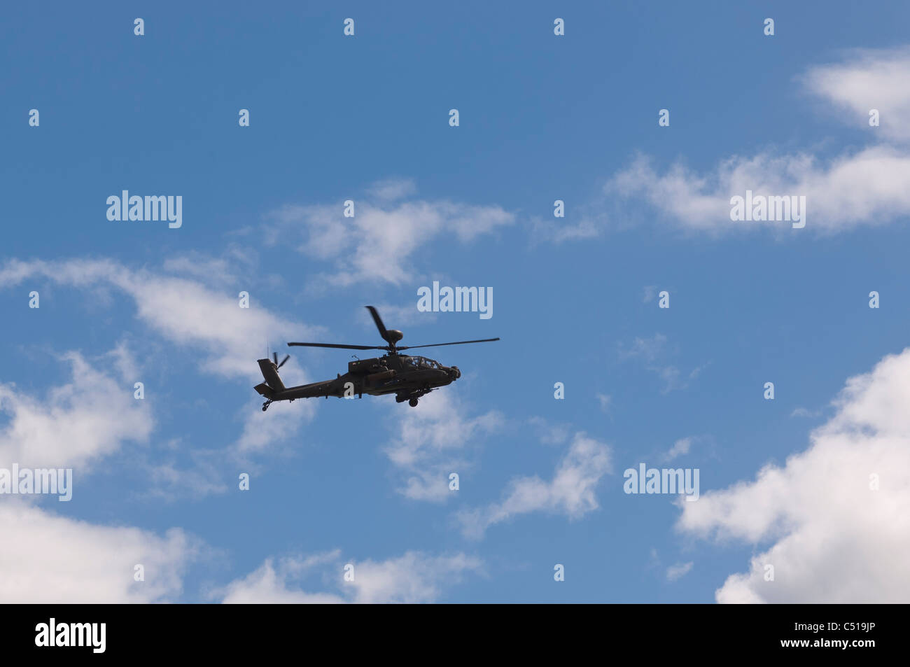 An Apache helicopter flying in the Uk - Stock Image