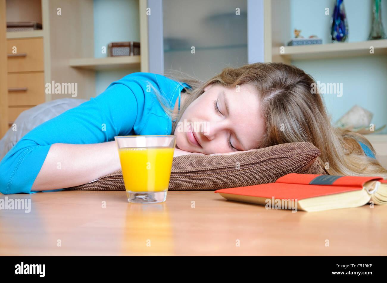 Woman sleeping on the floor - Stock Image