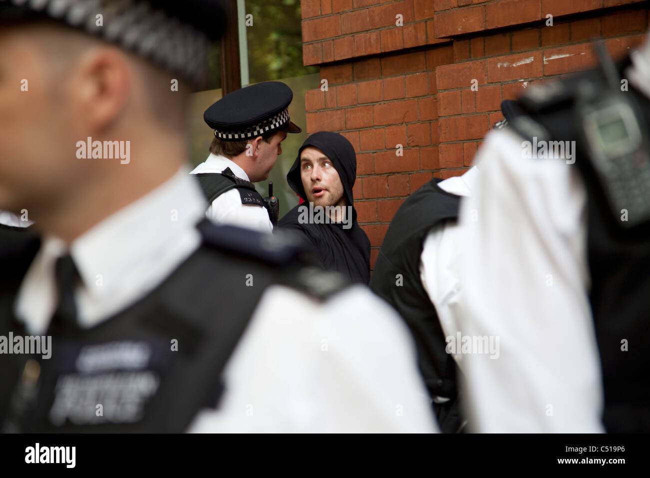 Police using their powers of stop and search during the general strike march in central London. - Stock Image