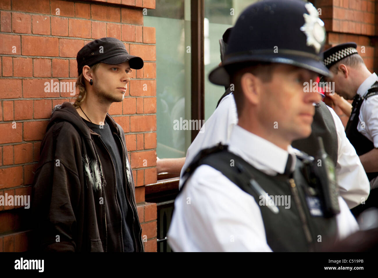 Police using their powers of stop and search during the general strike march in central London. UK. - Stock Image