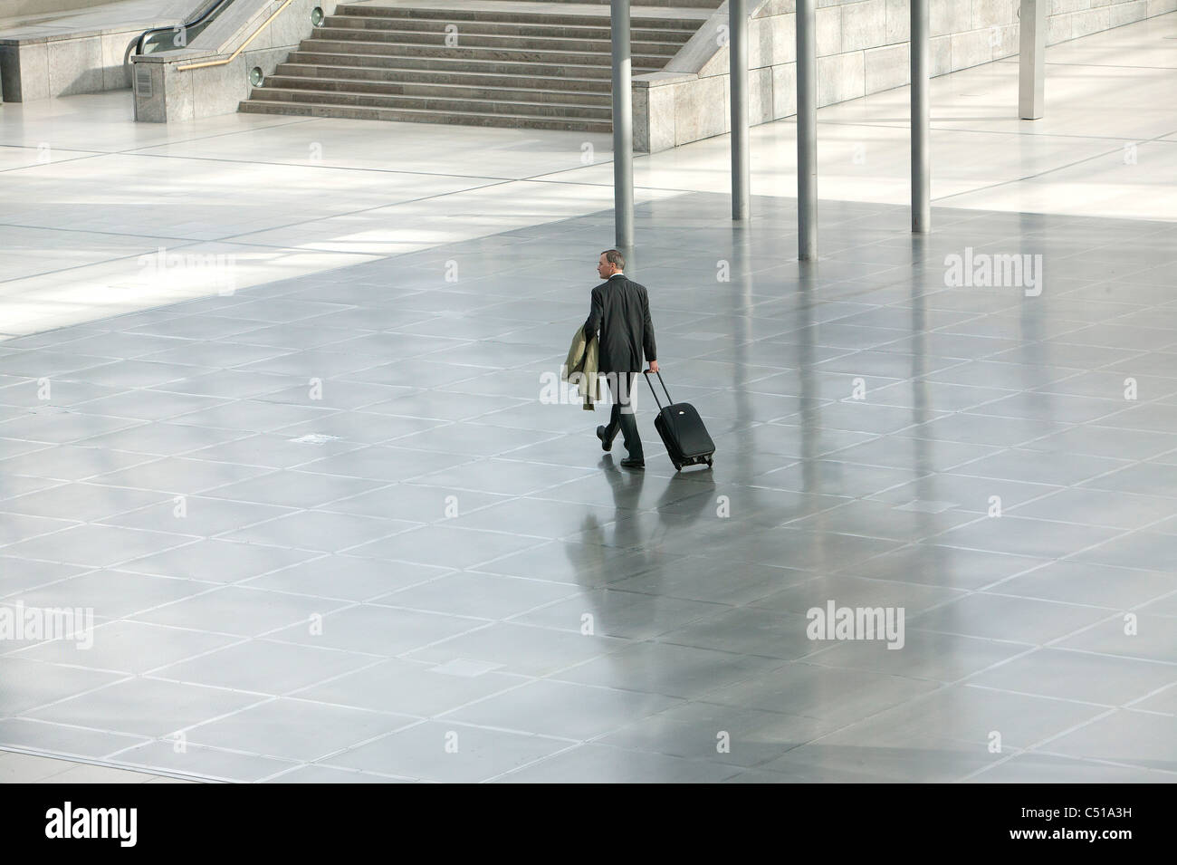 businessman walking through hall Stock Photo