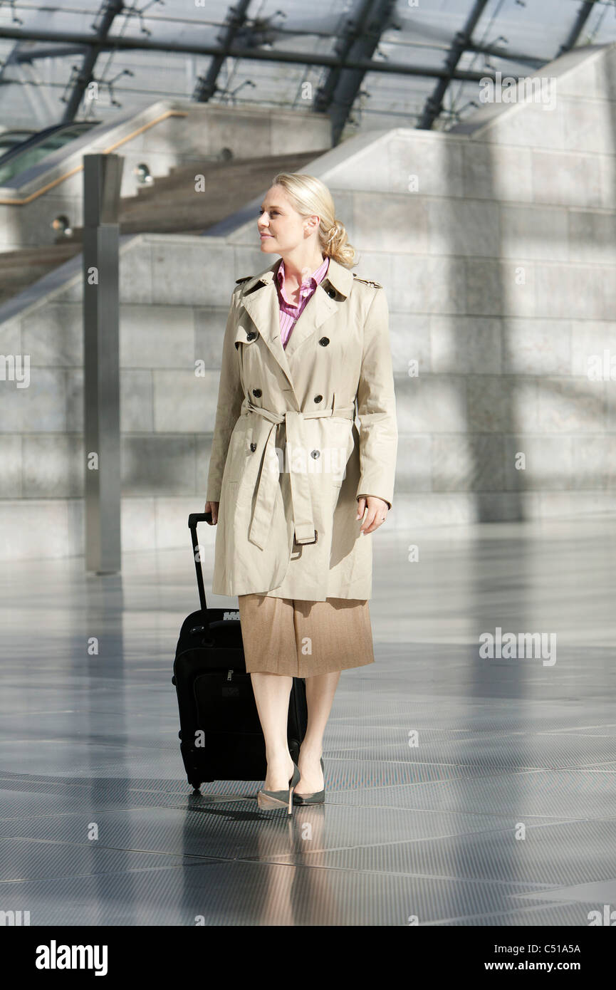 businesswoman with suitcase Stock Photo