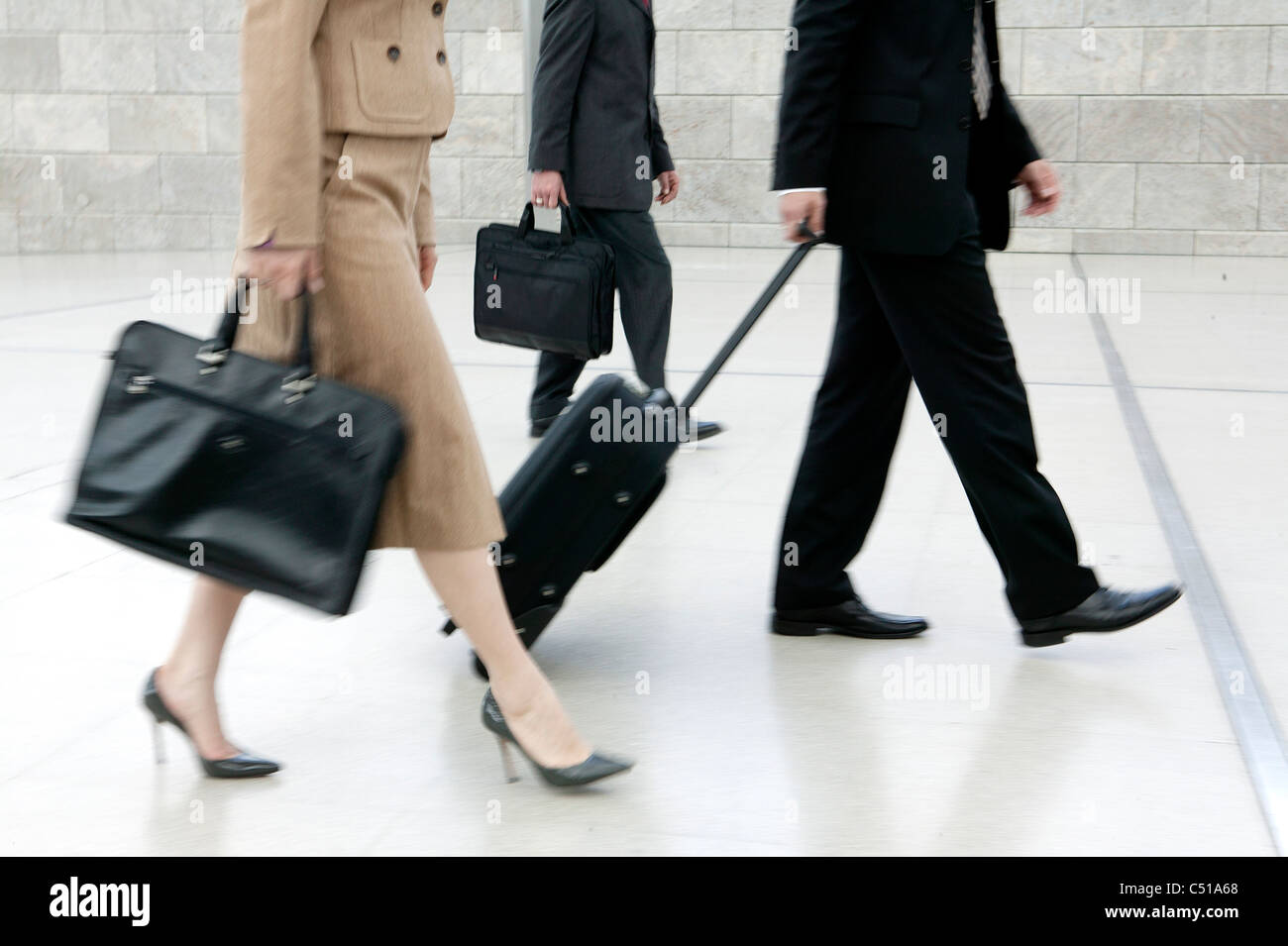 detail of business people with suitcases Stock Photo