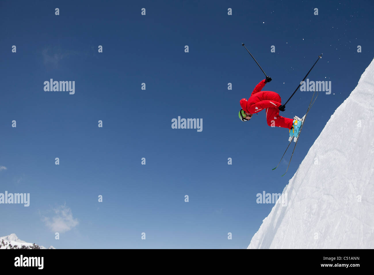 skier racing down the mountains - Stock Image