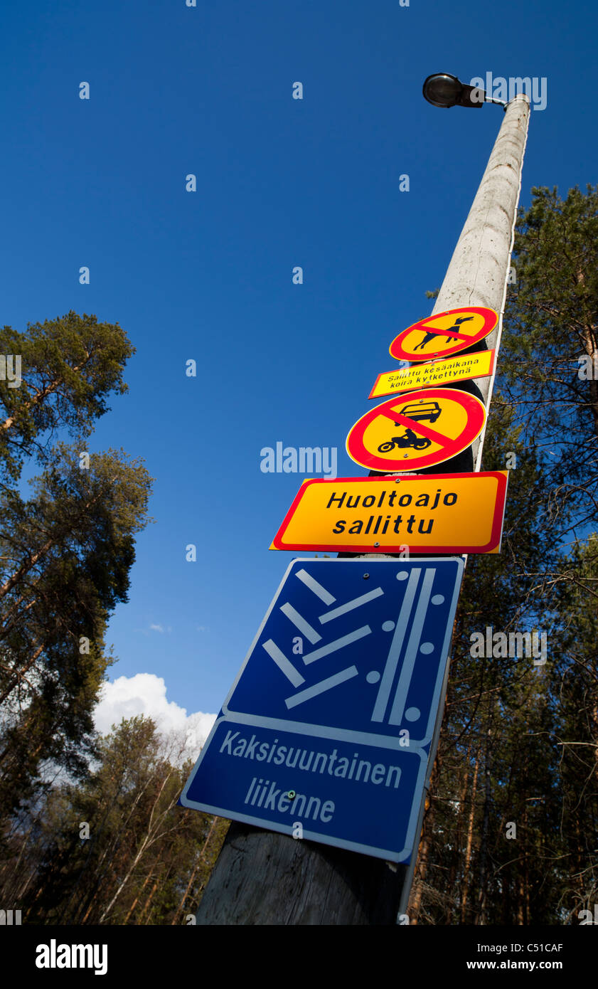 Finnish traffic signs on a skiing track denying dogs and motor vehicles - Stock Image