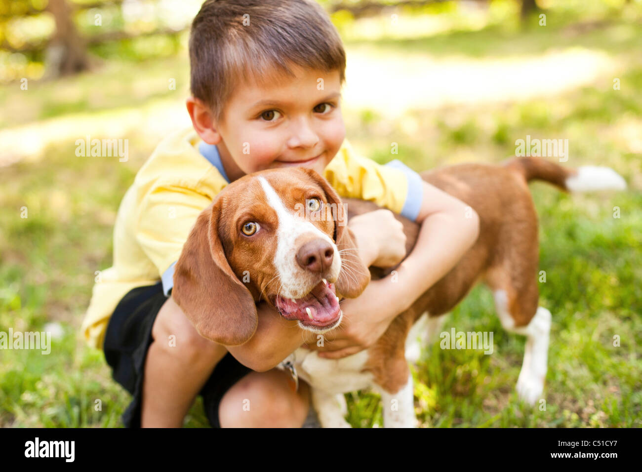 Portrait of Boy with Dog - Stock Image