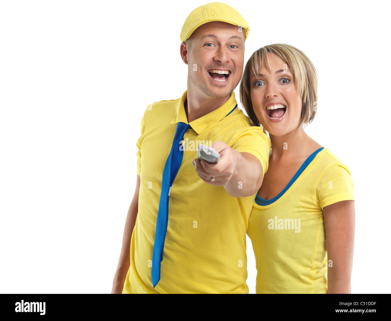 Laughing young couple with a TV remote control. Isolated on white background. - Stock Image