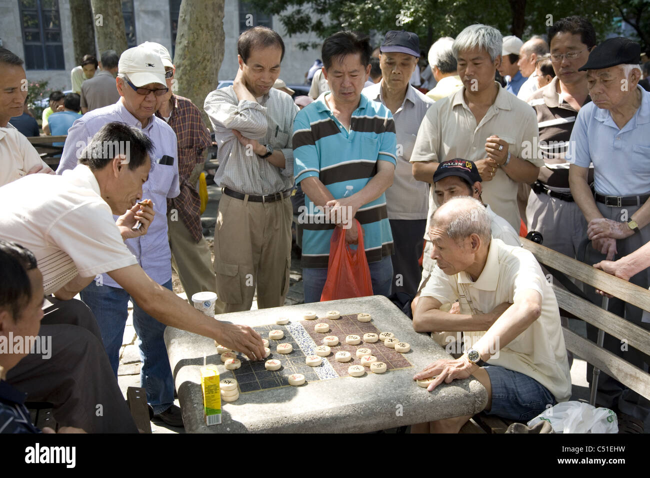 The park in Chinatown is a gathering place for Xiangqi (Chinese Chess) in New York City. - Stock Image