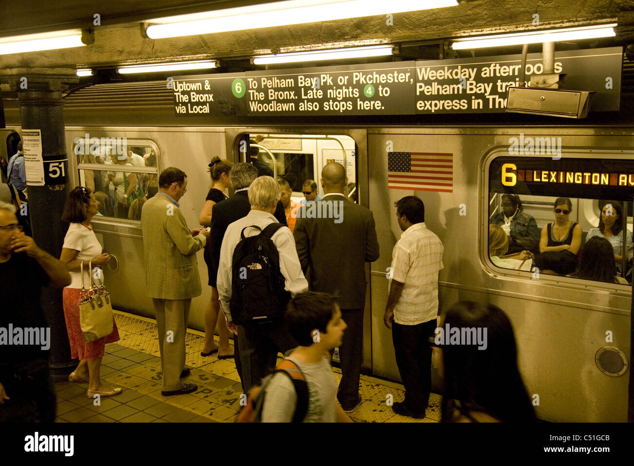Lexington local 6 subway train in the station at E. 51st Street in Manhattan. - Stock Image