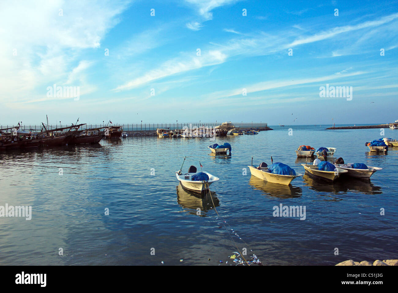 traditional old ships fisher men on a boat in kuwait harbor kuwait city - Stock Image