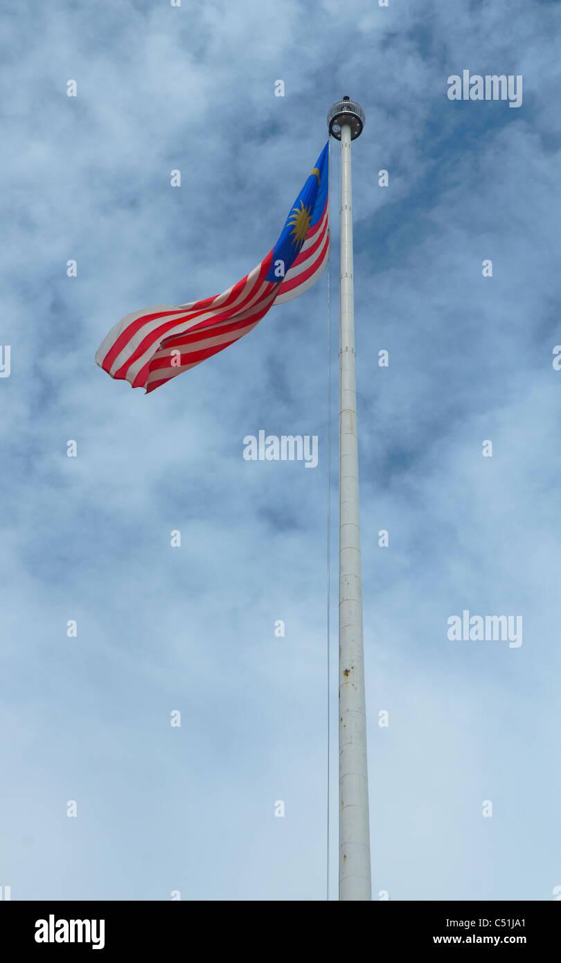 tall flagpole at Merdeka Square, one of the landmarks of the city of Kuala Lumpur, Malaysia - Stock Image