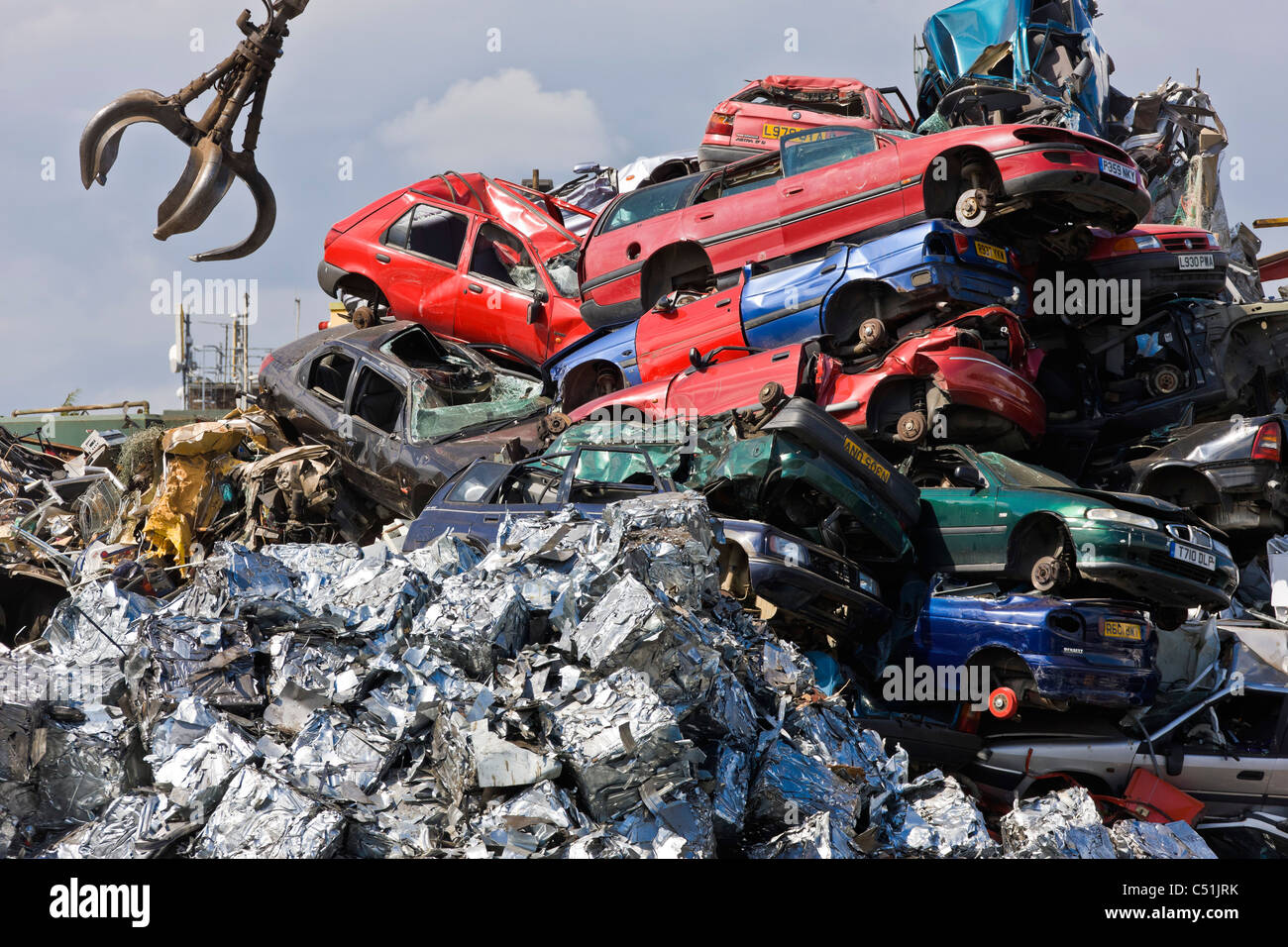 Unwanted old cars scrapped and crushed into cubes at recycling Stock ...