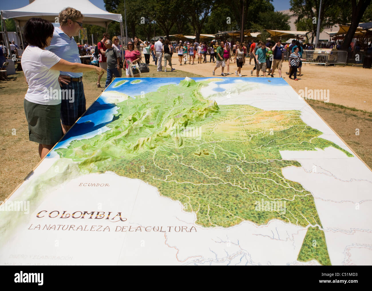 Topographic Map Of Colombia.A Couple Standing Next To A Large Three Dimensional Topographic Map