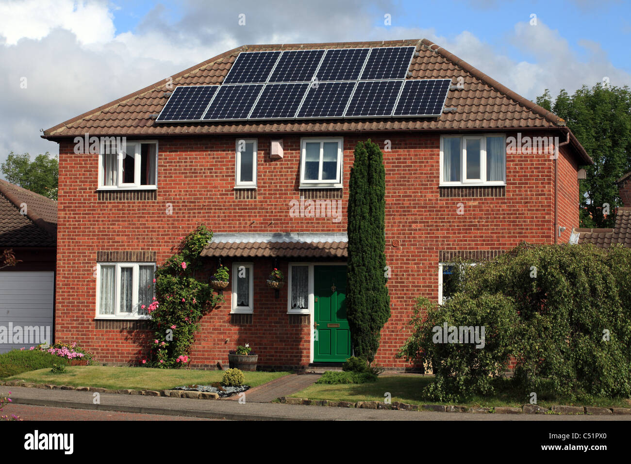 PV Photo voltaic Solar panels on detached house in England UK - Stock Image
