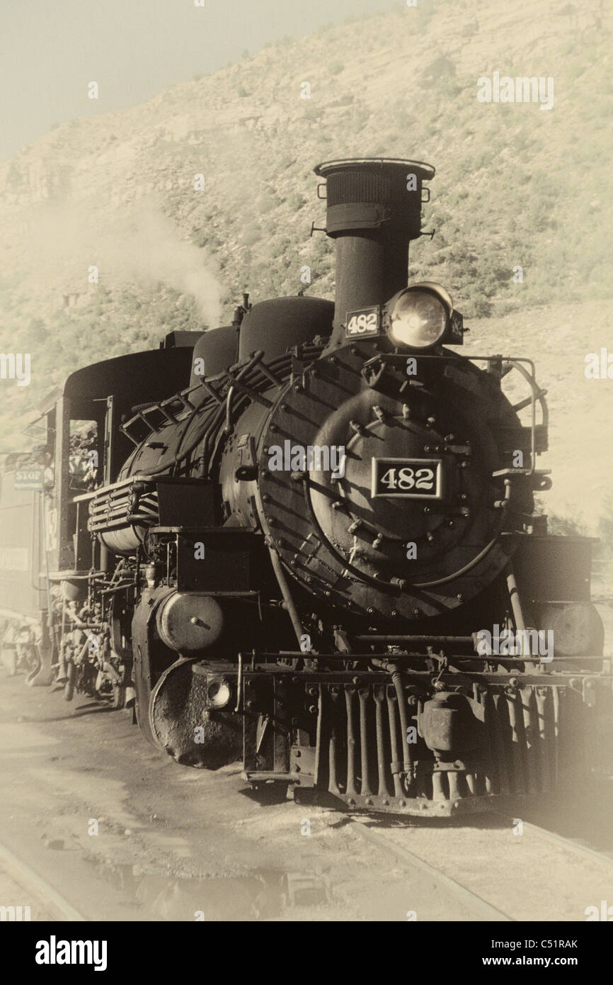 Front View of an Old Steam Locomotive in Antique Sepia Colors - Stock Image