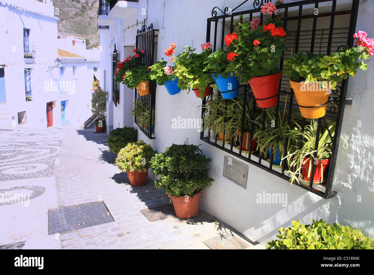 The quiet streets and pretty window boxes of picturesque Frigiliana in southern Spain - Stock Image