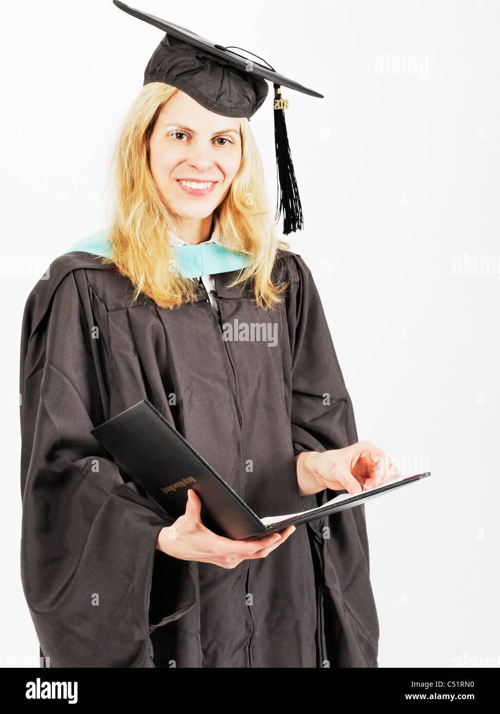 Close Up View of a Graduate in Ceremonial Dress Holding Certificate - Stock Image