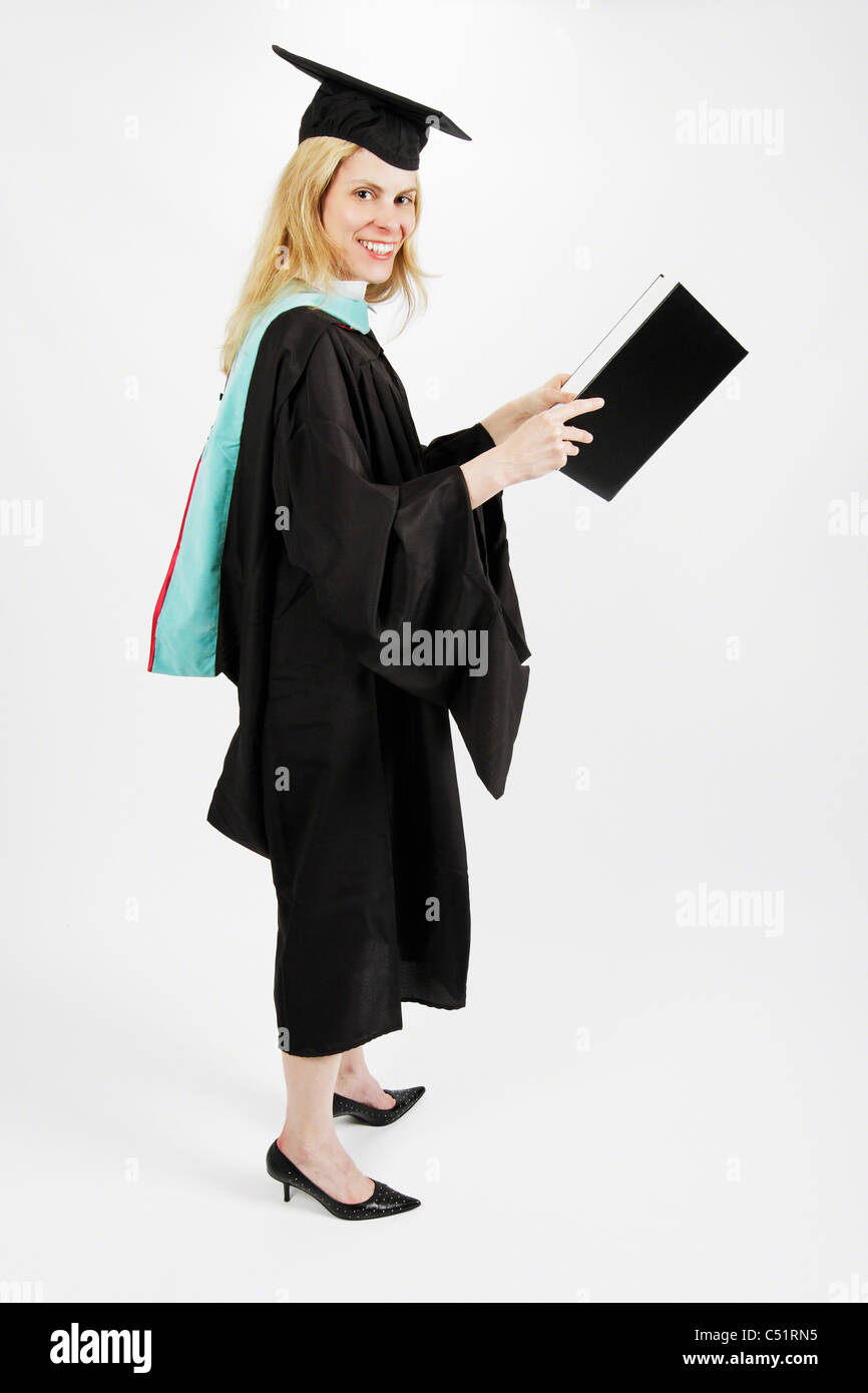 Young Woman Smiling While Holding a Graduate Degree Diploma - Stock Image