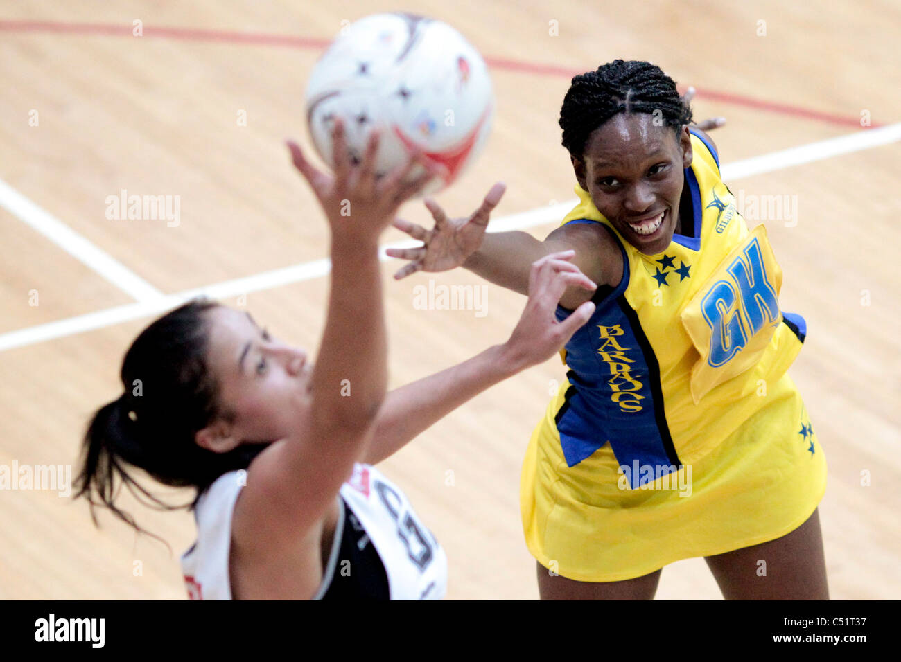 Laurel Browne of Barbados(yellow) attempts to intercept a pass to Maria Tutaia of New Zealand during a friendly - Stock Image
