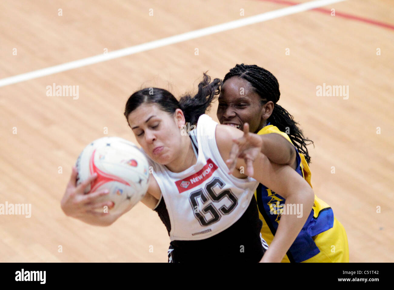Paula Griffin of New Zealand(left) and Laurel Browne of Barbados battle for the ball during a friendly match - Stock Image
