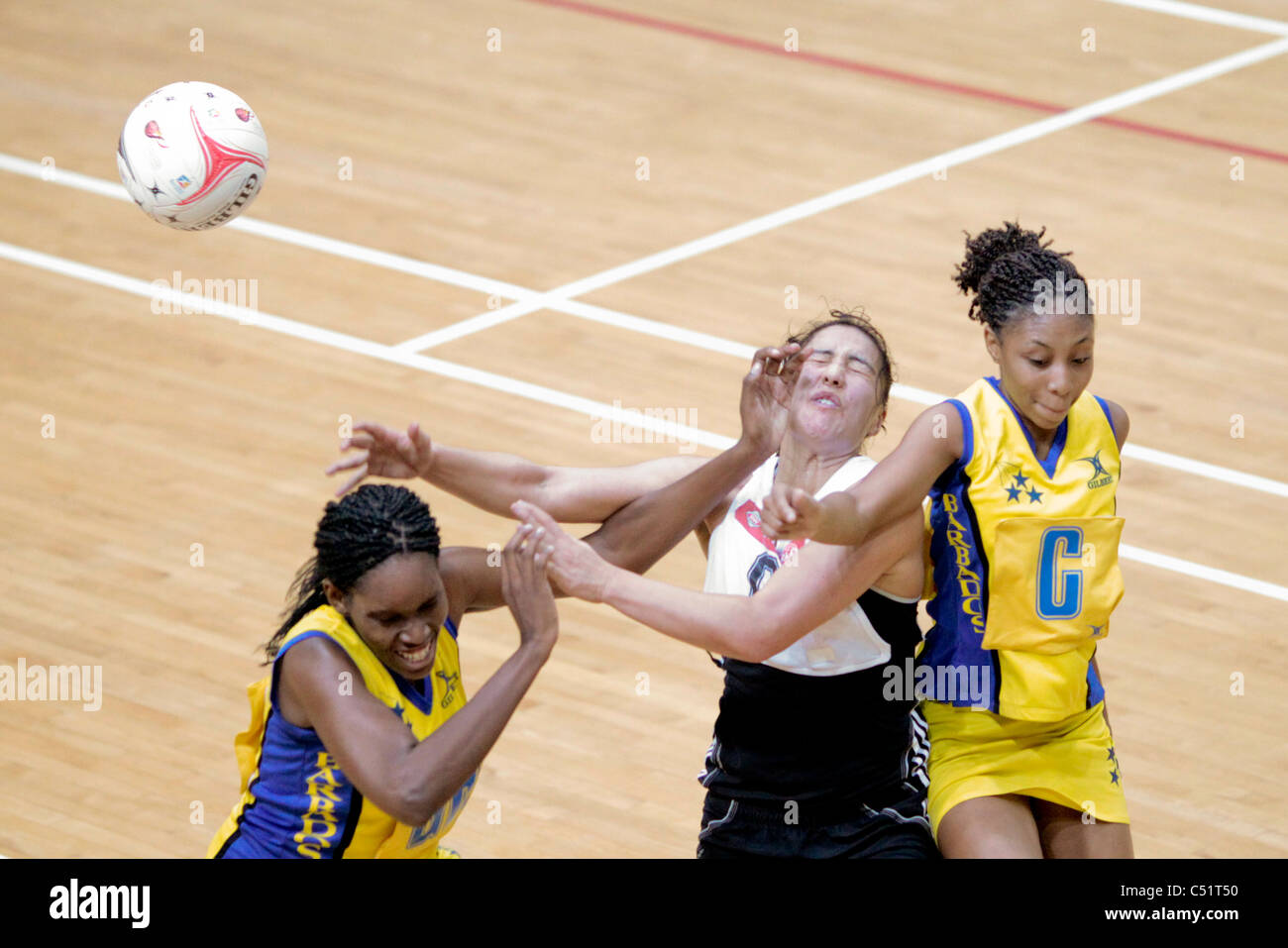 Players from Barbados(yellow) and New Zealand battle for the ball during a friendly match - Stock Image