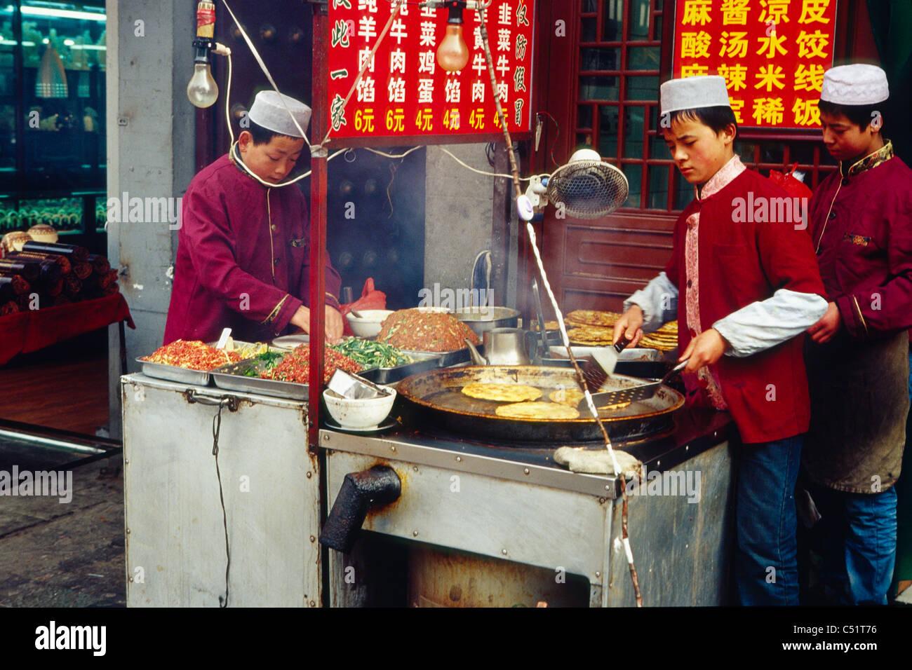 Outdoor Food Vendors Preparing Food, Muslim Street, Xian, China - Stock Image