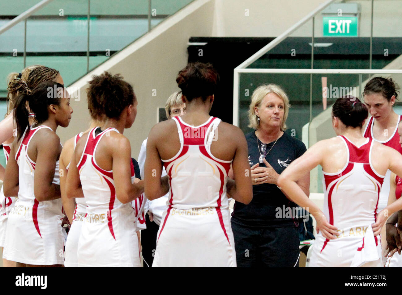 England coach Sue Hawkins(black) talks to the English team after their friendly match - Stock Image